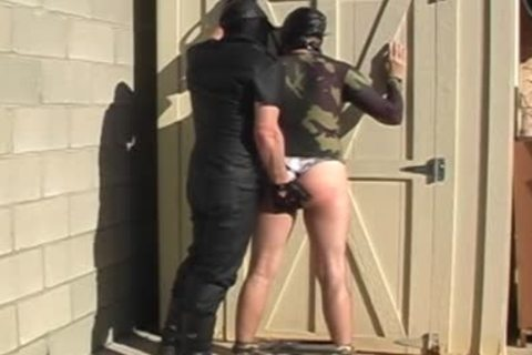 Masked males disrobe And bang Each Other outside