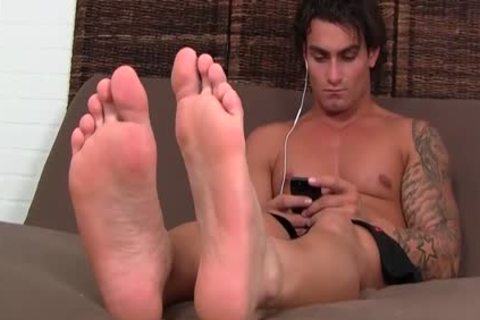 sexy brunette hair Vlad With Tattoos Shows Off His nice Toes