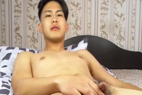 kinky Korean lad Tugging petite penis And Shotting Loads Of spooge